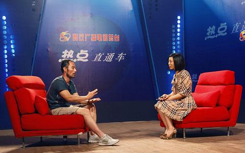 旭日阳刚王旭做客商丘广播电视台大型访谈节目《热点直通车》